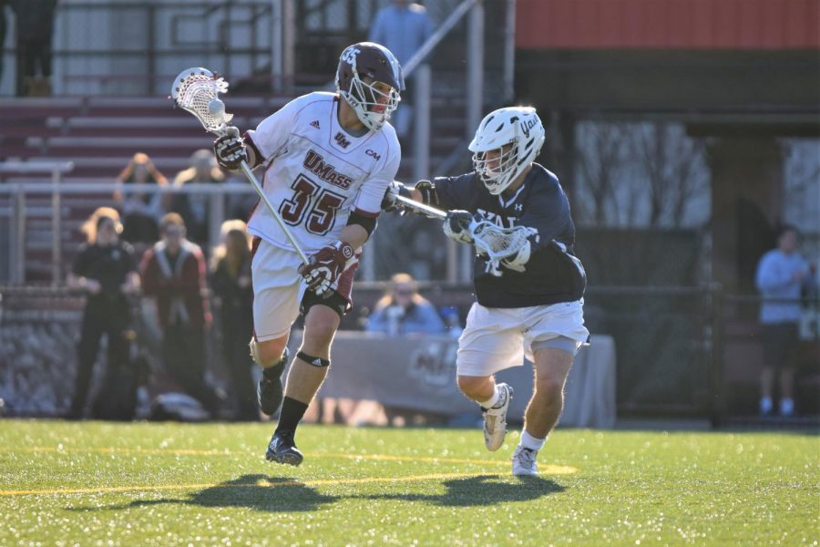 Buddy Carr drives to the net during UMass' regular season game against Yale.