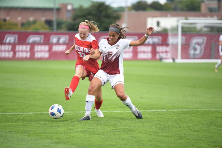 Rebeca Frisk (6) fights for the ball in UMass' 2-0 win over Duquesne Thursday, September 20, 2018. Frisk recorded an assist in UMass' victory.