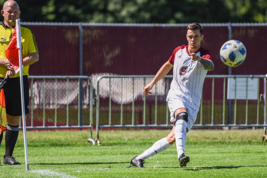Jack+Fulton+inserts+a+corner+kick+against+Central+Connecticut+State+on+Saturday%2C+September+15%2C+2018.+Fulton+scored+two+penalty+kick+goals+as+UMass+beat+CCSU+5-2.