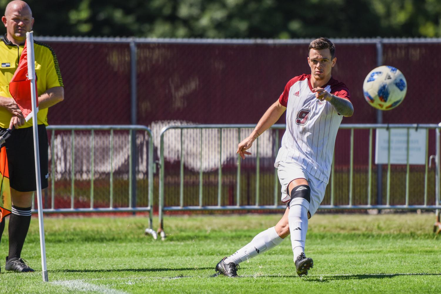 Jack Fulton inserts a corner kick against Central Connecticut State on Saturday, September 15, 2018. Fulton scored two penalty kick goals as UMass beat CCSU 5-2.