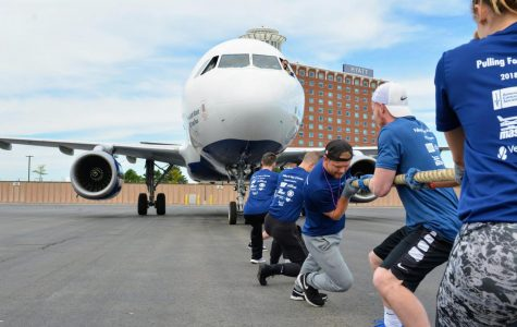 UMass powerlifting team pulls JetBlue airplane for cancer research fundraiser