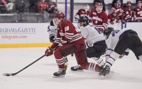 UMass tops Holy Cross to continue hot start