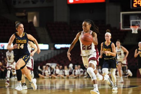 Doster, defense propell UMass past Duquesne