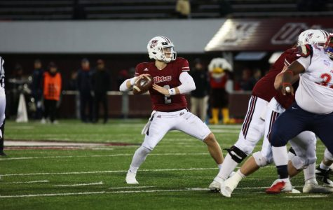 UMass comes back in fourth quarter to defeat Liberty in triple overtime