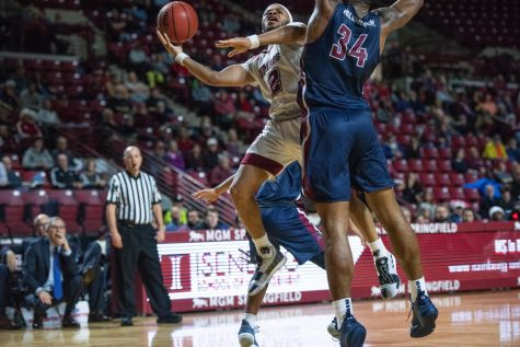 Minutemen escape Sacred Heart, 73-65, on Wednesday