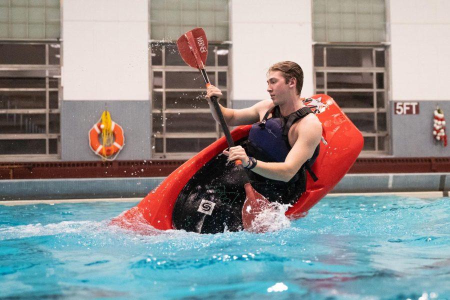 JR Jennings kayaking in Totman