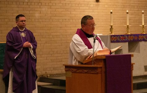 Dozens celebrate Ash Wednesday at the Newman Center