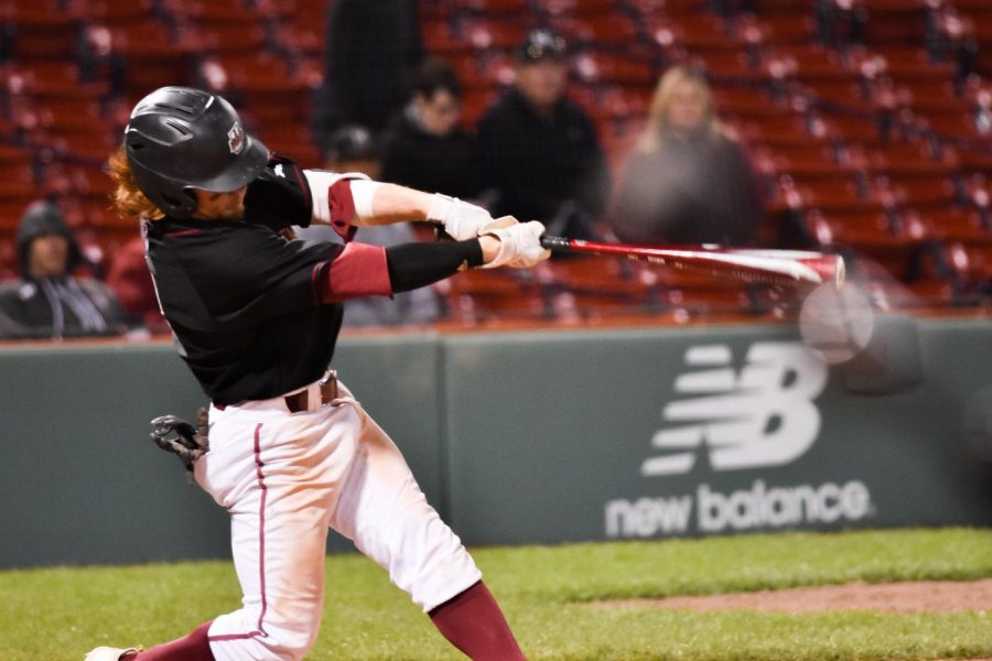 Sophomore center fielder Luke Oliphant bats for UMass baseball against Harvard in the Beanpot Championship game at Fenway Park in Boston on April 17, 2019. (Joe Frank/Collegian)