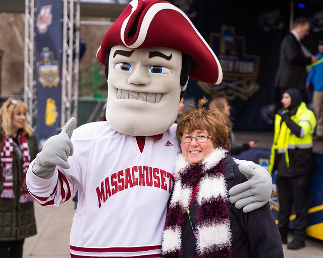 Joanne Keller takes a photo with Sam the Minuteman outside the Keybank Center in Buffalo, NY, on Saturday, Apr. 13, 2019. Photo by Jon Asgeirsson.