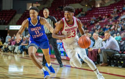 TJ Weeks shines, pours in 23 in UMass debut