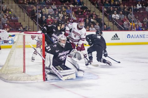 Minutemen end road woes; goalie carousel continues