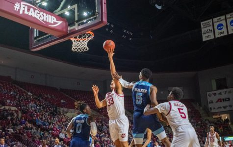 Tre Mitchell's late game heroics weren't enough in UMass' loss to URI