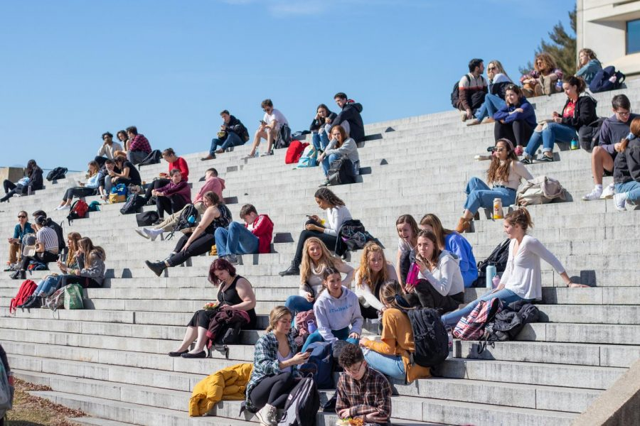 Students gather on the steps of the Campus Center of the University of Massachusetts to enjoy the unseasonably warm weather on Feb. 24. Photo by Nina Walat